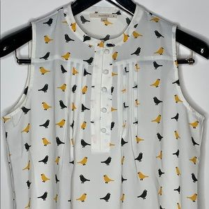 Gold and black sleeveless bird print button up top
